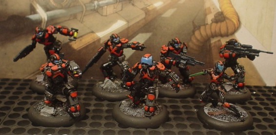 New MERC Keizai Waza fig front row, far right. Cause nuthing sez 'assassin' like a chick with a katana.
