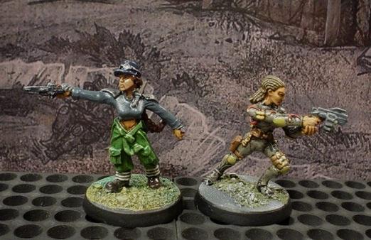 Urban War Mech pilot on the left. Female Junker gladiatrix on the right.