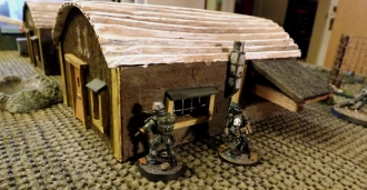 The Marked One and ZERT soldier take cover behind barracks