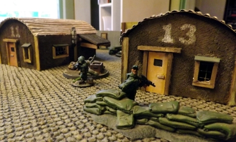 Military advances up the left, using old barracks for cover.