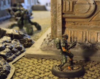 Grenade Launcher sprints to join PLF squad angling for the cache on right flank.