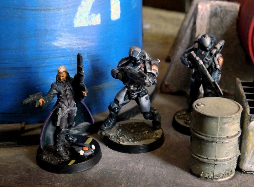 Another Infinity Bounty hunter, Father Somebody Italian-sounding, IIRC. He arrived with a mangled hand, hence the unauthorized sidearm.  He's backed up by two new Yu Jing troopers.